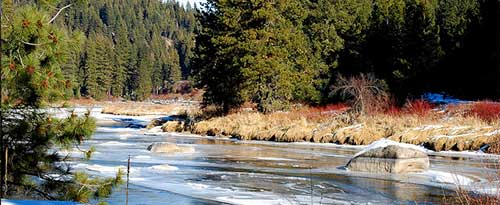 Payette river in December with some snow and chunks of ice in the river